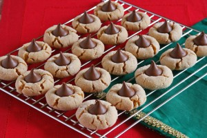 Peanut Butter Blossoms cookie recipe with Kisses Deluxe. A combination of roasted hazelnuts, delicate crisps and layers of rich, creamy chocolate.