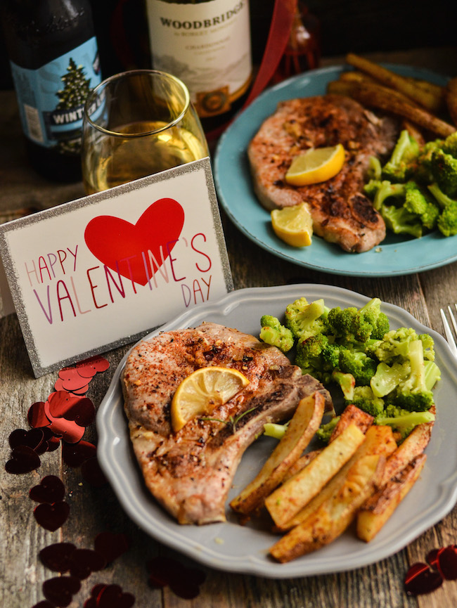 Rosemary Pork Chops recipe is the perfect Valentine's Day meal for you & yours with baked potato wedges & steamed broccoli ending with Raspberry Galette.