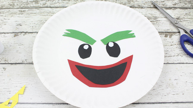 The Joker Paper Plate Craft Tutorial is my favorite. I don't know if it's the hair or what but it is definitely the most fun looking.