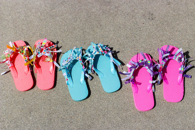 With today being National Flip Flops Day, nothing is more fitting than a DIY Ribbon Flip Flops Craft. Keep the kids busy when they are stuck inside!