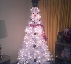 How to make a snowman Christmas tree for under $50. Being displaced at mom's house with no Christmas decorations, I was able to improvise & make it special.