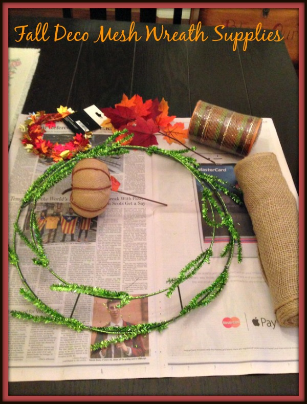 The Fall Deco Mesh Wreath I used burlap and a brown mesh to give it some accent. I used a burlap pumpkin, wire garland & some fall leaves as embellishments.
