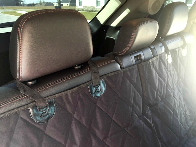 4Knines Dog Car Seat Cover installs on the headrests and can be adjusted quickly. Available in Black, Tan and Grey for back seats in cars, SUV's and Trucks.