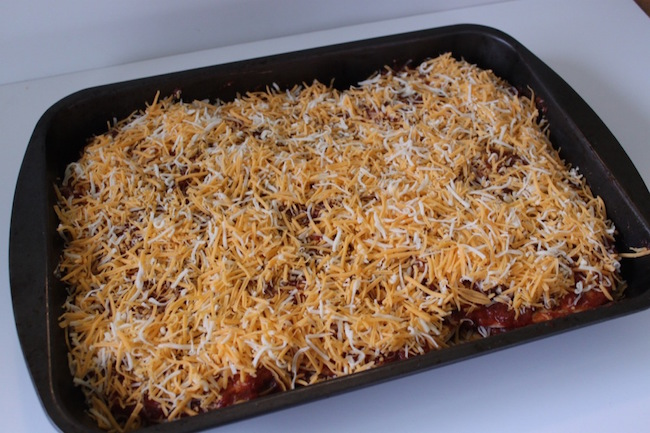 Chicken Enchilada Casserole is a Quick, easy to make, delicious, chicken enchiladas for a large group with homemade enchilada sauce.