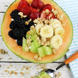Yogurt & Fruit Cantaloupe Boats are served in a cantaloupe half, stuffed with sweet, delicious fruits, berries, & topped with granola for a hearty crunch.