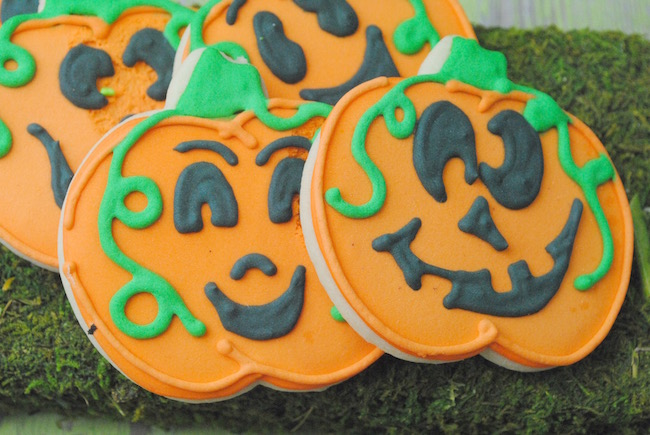 This Carved Pumpkin Cookie Recipe might look complicated but it really isn't. I think they are classy looking and will be the hit of your Halloween party.
