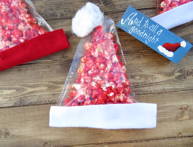 The kids will love helping you make the Popcorn Santa Hats recipe & are great for class parties or when you have the family coming over during the holidays.