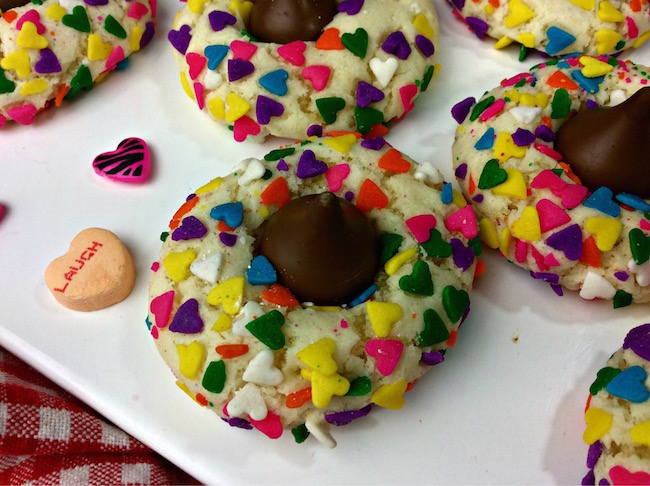 This Valentine's Day Kiss Sprinkle Cookies recipe is perfect for taking to the office, to school for Valentine's Day party or just to have around the house.