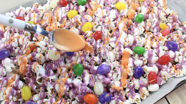 The kids will go crazy for this Jelly Bean Popcorn recipe. Simple to make and be a huge hit in the classroom, office or at home on movie night.