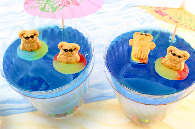 Since we are on a roll with cute mini desserts, let's sneak in a fun summer dessert that the kids will absolutely adore..Beach Days Jello Cups Recipe.
