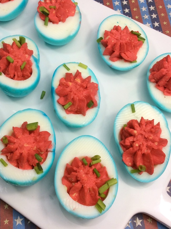 Who doesn't love deviled eggs? This year we are making them for our Memorial Day party with a twist, red, white, & blue Patriotic Deviled Eggs recipe.