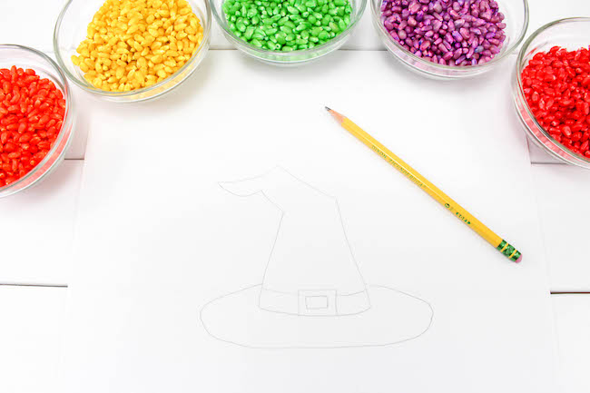 There are so many easy and fun Halloween decorations like this Witches Hat Corn Mosaic. It's easy to make and most likely you already the materials on hand.