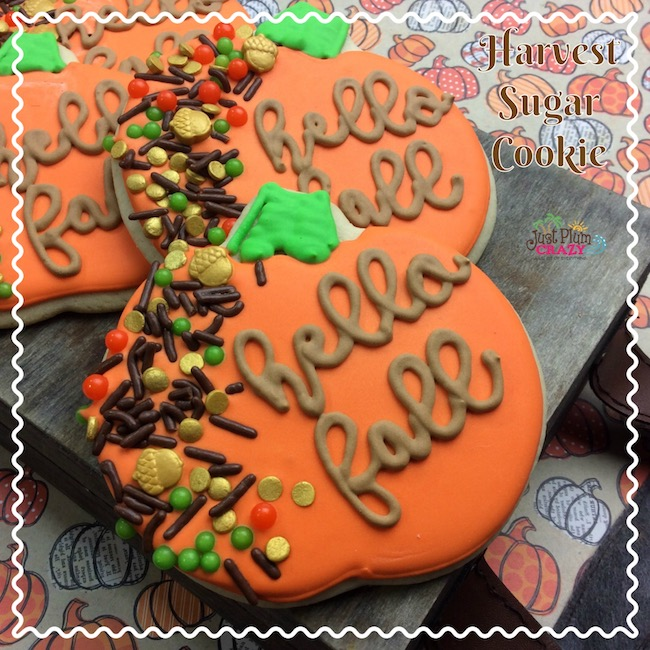 Pumpkin shaped sugar cookies with fall decorations.