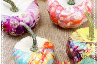 Nail polish pumpkins with varying marble designs.