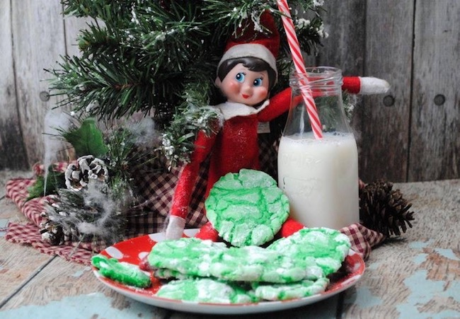 A little elf eating his cake mix crinkle cookies.