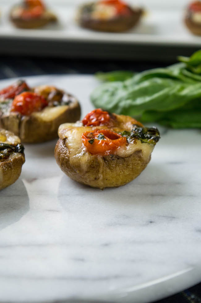 Stuffed mushrooms are one of the best appetizers. There are so many different ways to stuff them. If you want to celebrate National Stuffed Mushrooms Day, why not try the Stuffed Mushrooms Caprese Recipe.