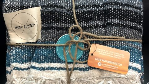 """The MNTN & MOON Lago Mexican Falsa Blanket came wrapped in reusable twine and measures 48"""" wide x 73"""" long. Made of 50% acrylic, 10% cotton, and 40% polyester, it's very soft. The blankets are handwoven by artisans in Mexico and hand finished in the United States."""