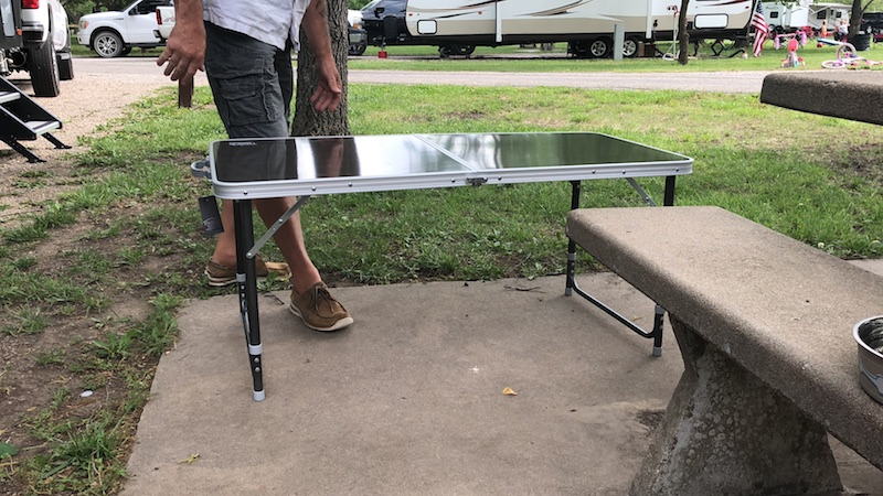 "A sturdy, stable camping table that measures 47"" x 23.5"" and weighs only 10 lbs. making it the perfect addition to our RV without the extra weight."