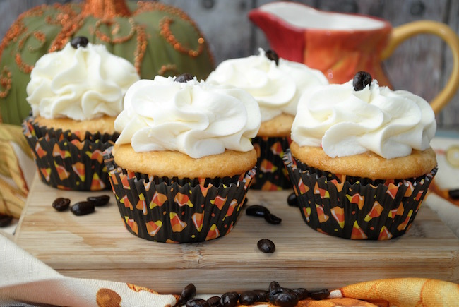 Pumpkin spice and vanilla cupcakes with a coffee bean accent.
